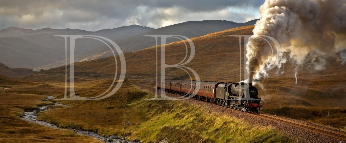 A small shaft of sunlight highlights Black 5 No. 45487 as it crosses the remote Rannoch Moor near Corrour, West Highlands of Scotland on 11th October 2008.